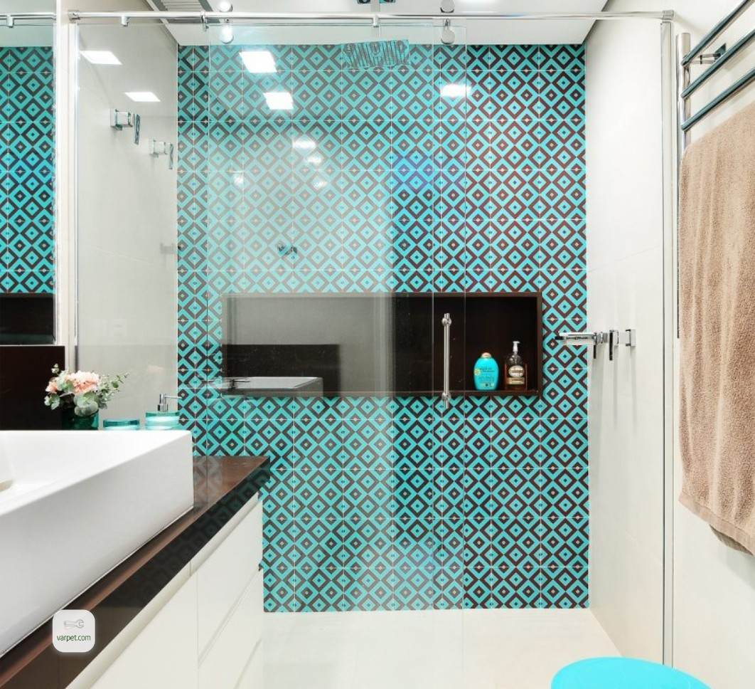 The shower area with bright turquoise tiles