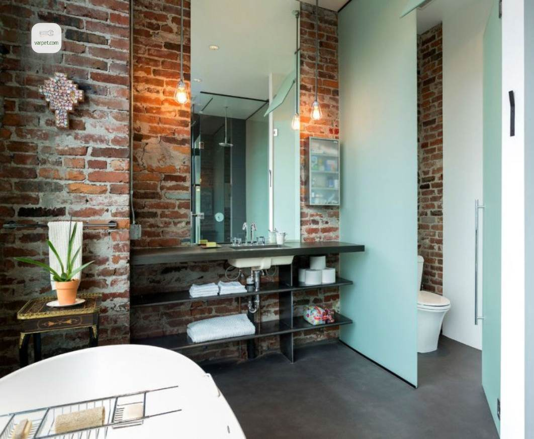 the bathroom with decorative brick